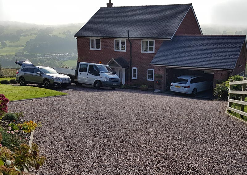 Sloping gravel driveway solution project in Derwen, North Wales