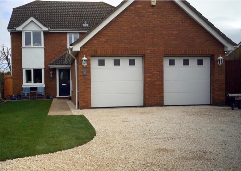 Tarmac overlaid with a gravel driveway using Gravelrings in Flitwick, Bedfordshire